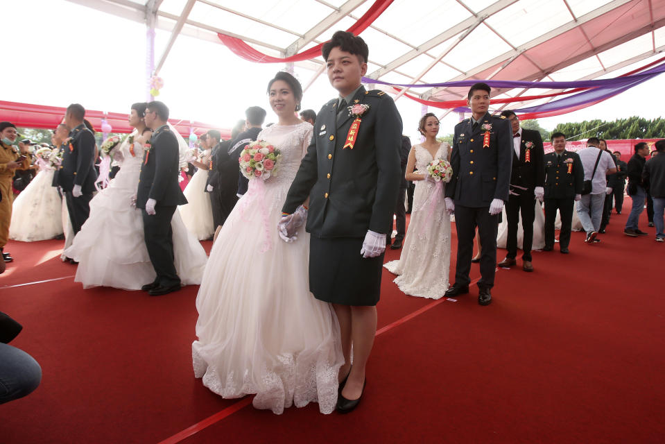 Lesbian couple Chen Ying-hsuan, right, and Li Li-chen attend a military mass weddings ceremony in Taoyuan city, northern Taiwan, Friday, Oct. 30, 2020. Two lesbian couples tied the knot in a mass ceremony held by Taiwan's military on Friday in a historic step for the island. Taiwan is the only place in Asia to have legalized gay marriage, passing legislation in this regard in May 2019. (AP Photo/Chiang Ying-ying)