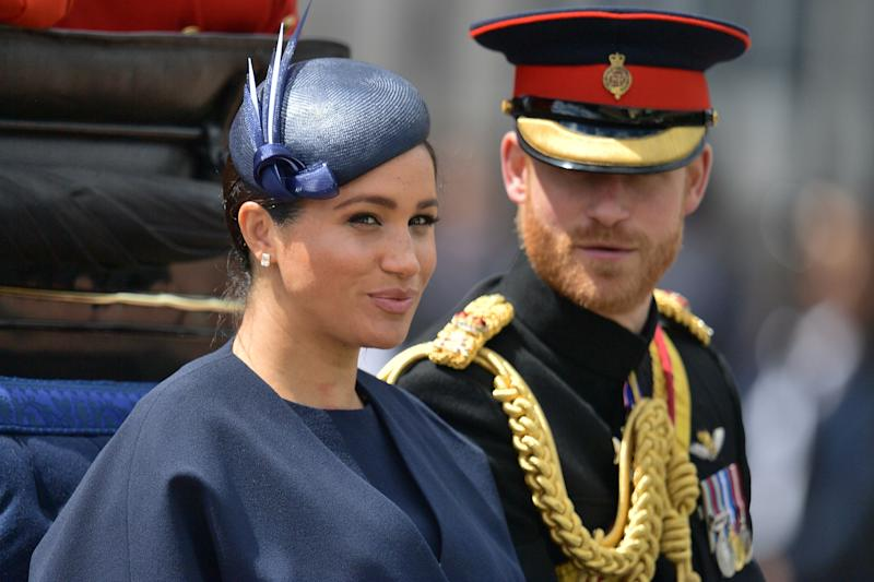 Britain's Meghan, Duchess of Sussex (L) and Britain's Prince Harry, Duke of Sussex (R) return to Buckingham Palace after the Queen's Birthday Parade, 'Trooping the Colour', in London on June 8, 2019. - The ceremony of Trooping the Colour is believed to have first been performed during the reign of King Charles II. Since 1748, the Trooping of the Colour has marked the official birthday of the British Sovereign. Over 1400 parading soldiers, almost 300 horses and 400 musicians take part in the event. (Photo by Daniel LEAL-OLIVAS / AFP) (Photo credit should read DANIEL LEAL-OLIVAS/AFP/Getty Images)