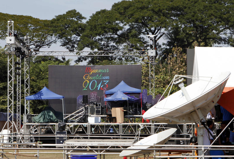 Workers take a rest as they prepare to set up a stage as preparations are underway for the country's first ever public New Year's countdown celebration, at Myoma grounds in Yangon, Myanmar, Monday, Dec. 31, 2012. (AP Photo/Khin Maung Win)