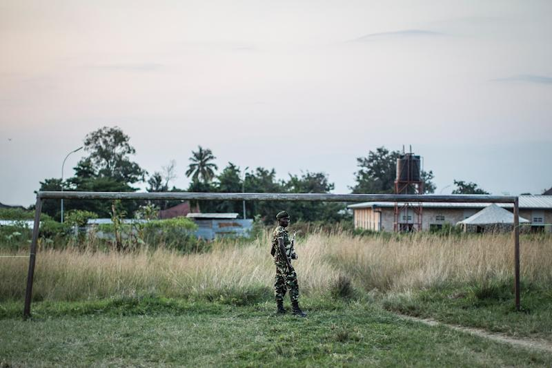 A Burundi soldier patrols in Musaga neighbourhood in Bujumbura (AFP Photo/Marco Longari)