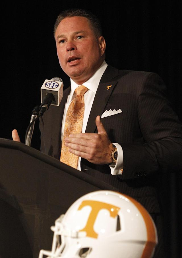 Tennessee coach Butch Jones speaks to the media at the Southeastern Conference NCAA college football media days, Tuesday, July 15, 2014, in Hoover, Ala. (AP Photo/Butch Dill)