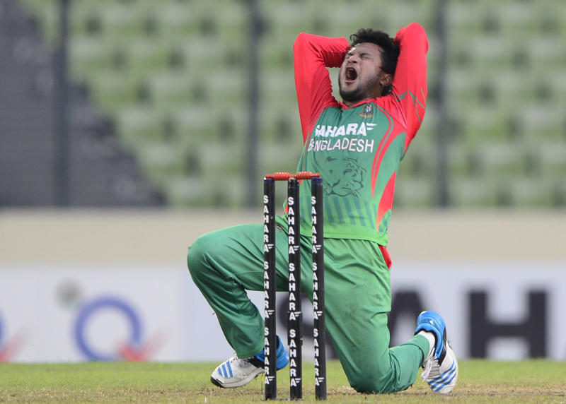Bangladeshi cricketer Shakib Al Hasan reacts as he appeals unsuccessfully for a leg before wicket decision India at the Sher-e-Bangla National Cricket Stadium in Dhaka, June 19, 2014