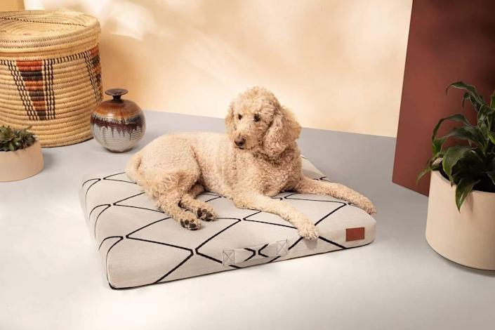 "$180, Laylo Pets. <a href=""https://www.laylopets.com/collections/all/products/altuzarra-x-laylo-pets-ecru-diamond-dog-bed-or-bed-cover?variant=31922992283720"" rel=""nofollow noopener"" target=""_blank"" data-ylk=""slk:Get it now!"" class=""link rapid-noclick-resp"">Get it now!</a>"