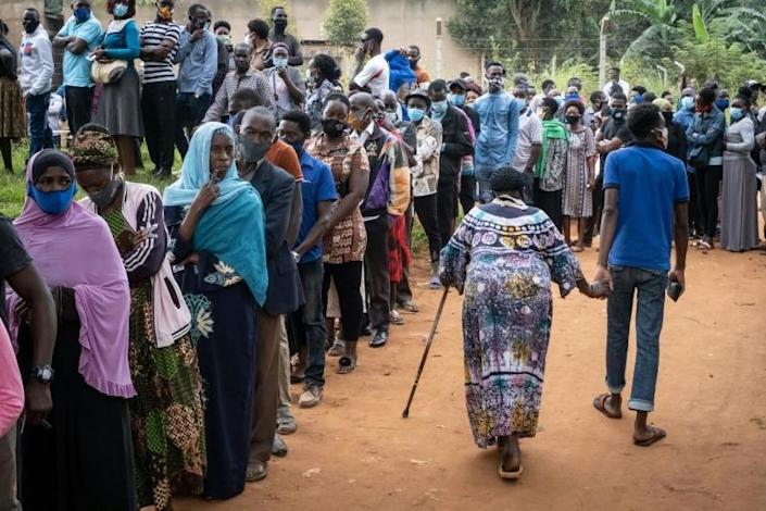 Voters queue at a polling station in Magere, Uganda