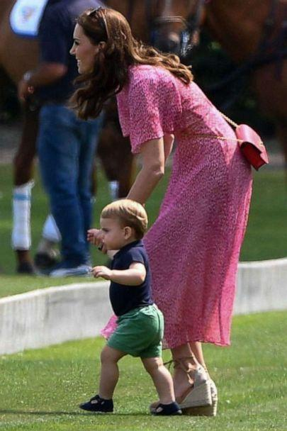 PHOTO: Catherine Duchess of Cambridge and Prince Louis are seen walking at the King Power Royal Charity Polo Day at Billingbear Polo Club in Wokingham, UK on July 10, 2019. (Tim Rooke/REX)