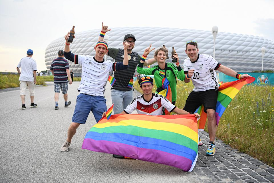 MUNICH, GERMANY - JUNE 23: Fans of Germany stay together with a rainbow flag ahead of the UEFA Euro 2020 Championship Group F match between Germany and Hungary at Football Arena Munich on June 23, 2021 in Munich, Germany. (Photo by Markus Gilliar/Getty Images)