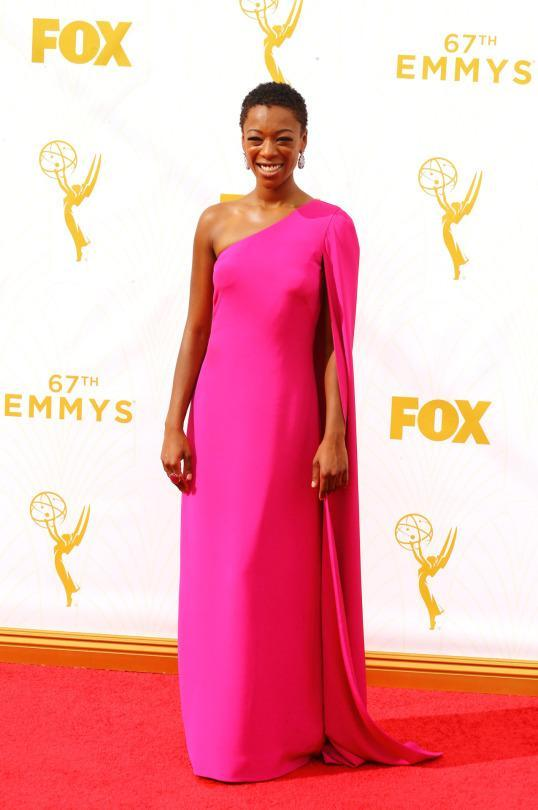 """<p>Samira Wiley was recently tapped as the face of Christian Siriano, so it comes as no surprise that they couple up on the Emmys red carpet. In a hot pink one-shoulder gown, the """"Orange Is the New Black"""" star's gown had a one-shoulder cape cascading down as well. </p>"""
