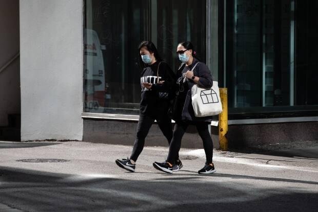 Pedestrians on Robson Street in downtown Vancouver on Sept. 15. (Maggie MacPherson/CBC - image credit)