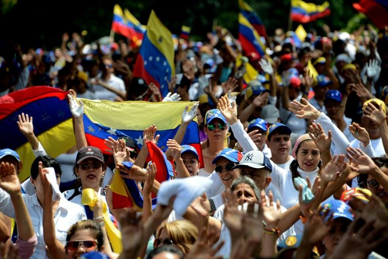 Venezuelan opposition activists join a silent march in protest at the government of President NIcolas Maduro, in the border state of Tachira-San Cristobal