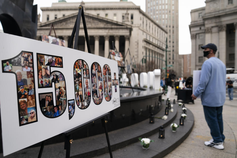 "FILE — Demonstrators gather beside a presentation depicting the number 15,000 to denote estimated nursing home deaths, before a rally decrying New York Governor Andrew Cuomo's handling of the previous year's outbreak of COVID-19, in New York. Cuomo's office said it won't reveal what it told the U.S. Justice Department about COVID-19 outbreaks in nursing homes, partly because doing so would be an ""invasion of personal privacy.""(AP Photo/John Minchillo, File)"
