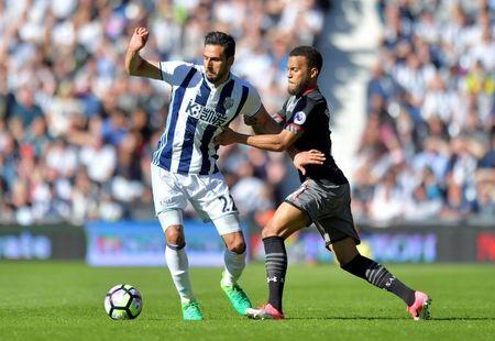 West Bromwich Albion's Nacer Chadli in action with Southampton's Ryan Bertrand