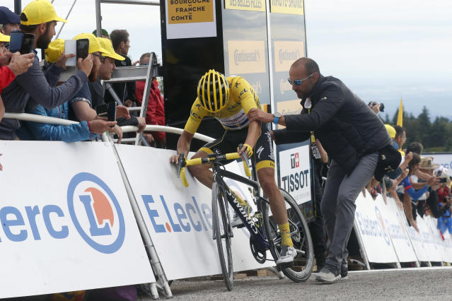 France's Julian Alaphilippe wearing the overall leader's yellow jersey reacts as he crosses the finish line of the sixth stage of the Tour de France cycling race over 160 kilometers (100 miles) with start in Mulhouse and finish in La Planche des Belles Filles, France, Thursday, July 11, 2019. (AP Photo/Thibault Camus)
