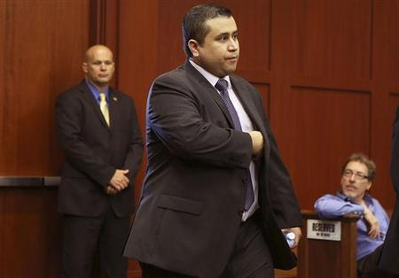 George Zimmerman enters the courtroom for his trial in Sanford