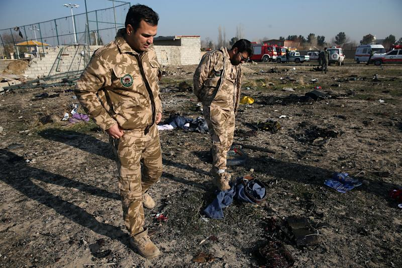 Security look at passengers' belongings at the site where the Ukraine International Airlines plane crashed after take-off from Iran's Imam Khomeini airport, on the outskirts of Tehran, Iran January 8, 2020. (Photo: Nazanin Tabatabaee/WANA (West Asia News Agency) via Reuters)