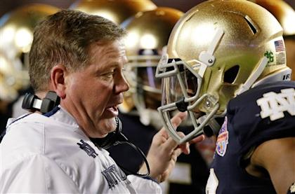 Coach Brian Kelly and the Irish had a rough finish to a season that started 12-0. (AP)