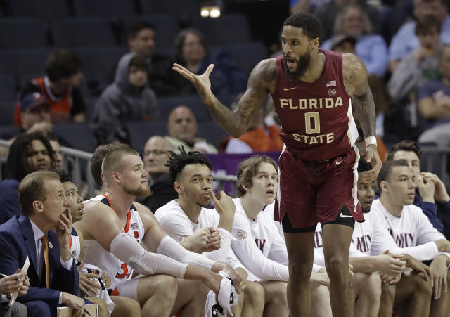 Florida State's Phil Cofer (0) gestures toward the Virginia bench after making a basket during the first half of an NCAA college basketball game in the Atlantic Coast Conference tournament in Charlotte, N.C., Friday, March 15, 2019. (AP Photo/Chuck Burton)