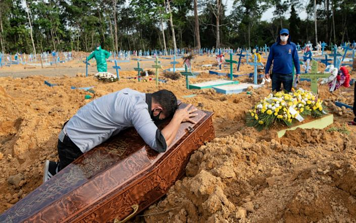 Mourning at the grave of Iris Goncalves Alves who died aged 54 - Simon Townsley