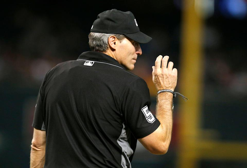 MLB umpire Angel Hernandez (5) in the first inning during a game between the Arizona Diamondbacks the San Diego Padres, Monday, Sept. 3, 2018, in Phoenix. (AP Photo/Rick Scuteri)