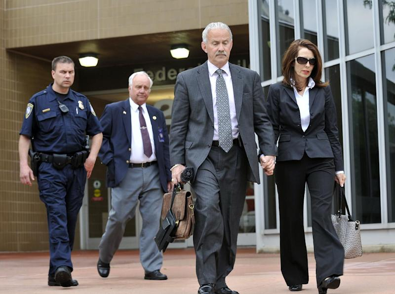 Former Michigan Supreme Court Justice Diane Hathaway, right, walks out of the Federal Building in Ann Arbor with her attorney Steve Fishman, 2nd from right,  after her sentencing for bank fraud, before U.S. District Judge Corbett O'Meara, Tuesday afternoon,  May 28, 2013, in Ann Arbor, Michigan.  She was sentenced to a year and a day in prison.  (AP Photo/Detroit News, )  DETROIT FREE PRESS OUT; HUFFINGTON POST OUT     ( John T. Greilick / The Detroit News )