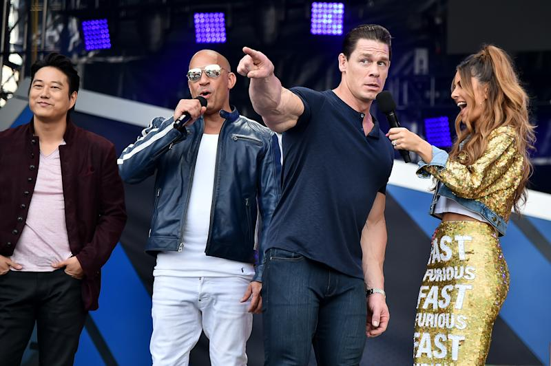 MIAMI, FLORIDA - JANUARY 31: (L-R) Sung Kang, Vin Diesel, John Cena and Maria Menounos speak onstage during Universal Pictures Presents The Road To F9 Concert and Trailer Drop on January 31, 2020 in Miami, Florida. (Photo by Theo Wargo/Getty Images for Universal Pictures)