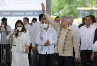"""Mexican President Andres Manuel Lopez Obrador waves to supporters in Lazaro Cardenas, Quintana Roo state, Mexico, Monday, June 1, 2020. Amid a pandemic and the remnants of a tropical storm, President Lopez Obrador kicked off Mexico's return to a """"new normal"""" Monday with his first road trip in two months as the nation began to gradually ease some virus-inspired restrictions. (AP Photo/Victor Ruiz)"""