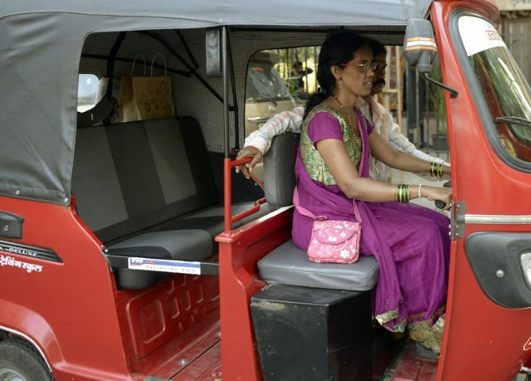 Female drivers receive different colour rickshaws to the traditional black and yellow ones, to discourage male relatives from taking them