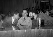 <p>From left to right: president of Caracas University Students' Federation Jesus Cardona, Venezuelan Rear Admiral Wolfgang Larrazabal, and Cuban revolutionary hero Fidel Castro are seen in Caracas, Jan. 25, 1959. Larrazabal was one of the leaders who helped overthrow Venezuelan dictator General Marcos Perez Jimenez in 1958. (AP Photo/Harold Valentine) </p>