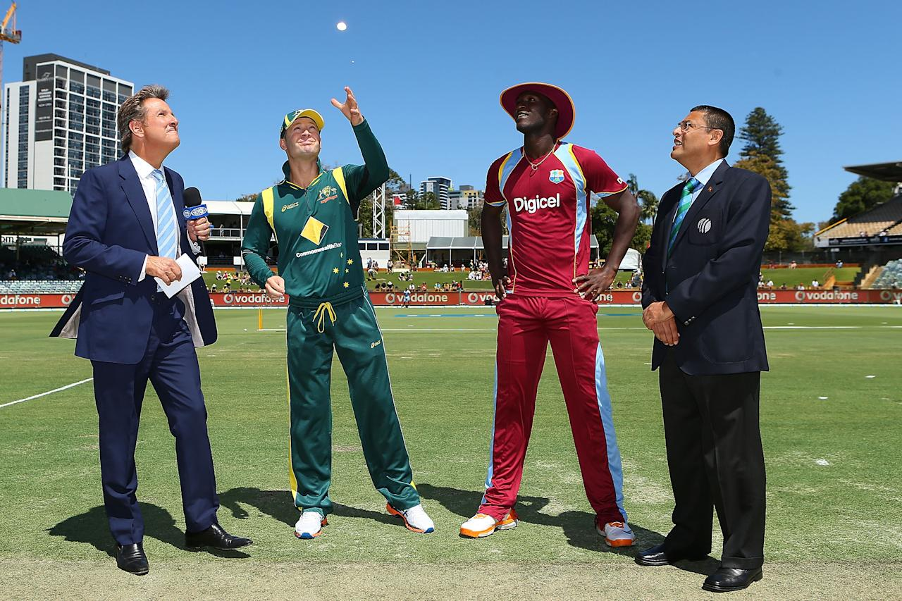 PERTH, AUSTRALIA - FEBRUARY 01: Michael Clarke of Australia and Devon Thomas of the West Indies attend the coin toss during game one of the Commonwealth Bank One Day International Series between Australia and the West Indies at WACA on February 1, 2013 in Perth, Australia.  (Photo by Paul Kane/Getty Images)