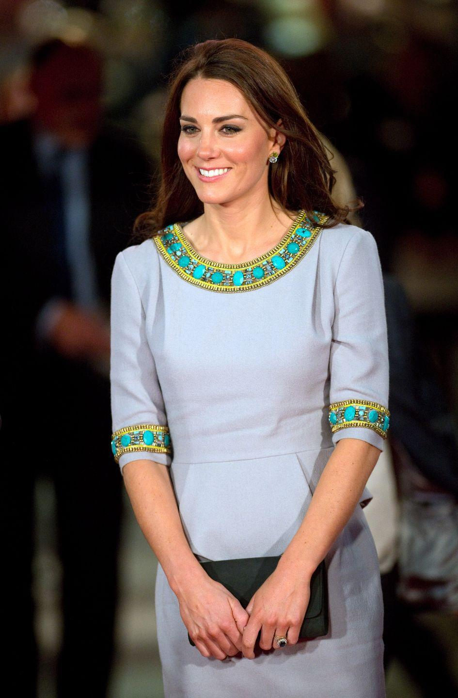 <p>This embellished gray Matthew Williamson peplum dress debuted when the duchess attended the premiere of African Cats in London. </p>