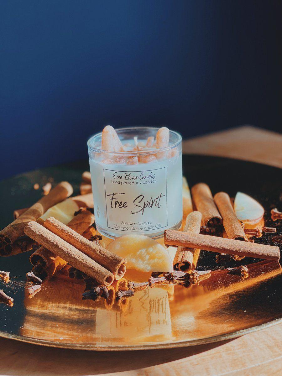 """<p><strong>One Eleven Candles</strong></p><p>oneelevencandles.com</p><p><strong>$11.00</strong></p><p><a href=""""https://oneelevencandles.com/collections/one-eleven-candles-online-squarespace-store/products/free-spirit-crystal-soy-candle"""" rel=""""nofollow noopener"""" target=""""_blank"""" data-ylk=""""slk:Shop Now"""" class=""""link rapid-noclick-resp"""">Shop Now</a></p><p> Not only does this cinnamon- and apple-scented candle smell <em>amazing, </em>you can also use it to refocus on your energy, thanks to the gorgeous sunstone crystals embedded in the wax. According to the description, sunstone encourages personal power, freedom, and joy. (And we love the sound of that!)</p>"""