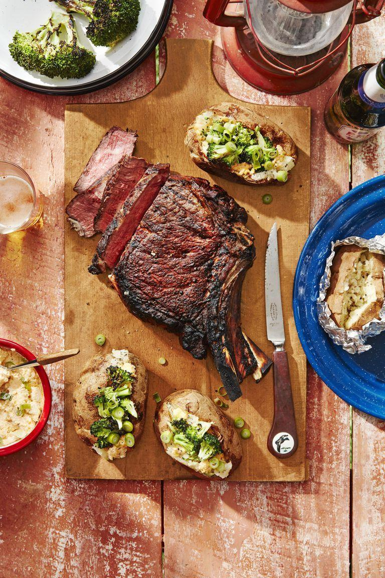 """<p>Even the biggest appetites will be satisfied with these bone-in rib eyes and cheesy baked potatoes. After you've prepared this meal once, your family will be begging for this steak and potatoes dinner again and again.</p><p><strong><a href=""""https://www.countryliving.com/food-drinks/a28189705/cowboy-steaks-and-potatoes-with-broccoli-and-cheddar-scallion-spread-recipe/"""" rel=""""nofollow noopener"""" target=""""_blank"""" data-ylk=""""slk:Get the recipe"""" class=""""link rapid-noclick-resp"""">Get the recipe</a>. </strong><br></p>"""