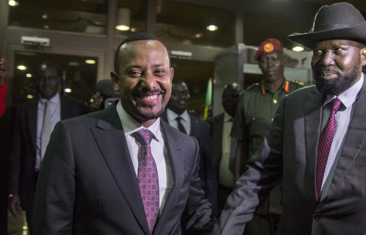 FILE - In this Wednesday, June 20, 2018, file photo, Ethiopia's Prime Minister Abiy Ahmed, left, greets South Sudan's President Salva Kiir, right, at his office in Addis Ababa, Ethiopia. An explosion disrupted a huge rally for Ahmed on Saturday, June 23, 2018, shortly after he spoke and was waving to the crowd that had turned out in numbers unseen in recent years in the East African nation. (AP Photo/Mulugeta Ayene, File)