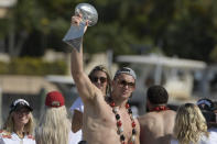 Tampa Bay Buccaneers NFL football tight end Rob Gronkowski holds up the Vince Lombardi trophy during a celebration of their Super Bowl 55 victory over the Kansas City Chiefs with a boat parade in Tampa, Fla., Wednesday, Feb. 10, 2021. (AP Photo/Phelan Ebenhack)