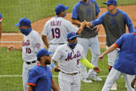 New York Mets' Yoenis Cespedes, center, celebrates with teammates after a baseball game against the Atlanta Braves at Citi Field, Friday, July 24, 2020, in New York. (AP Photo/Seth Wenig)