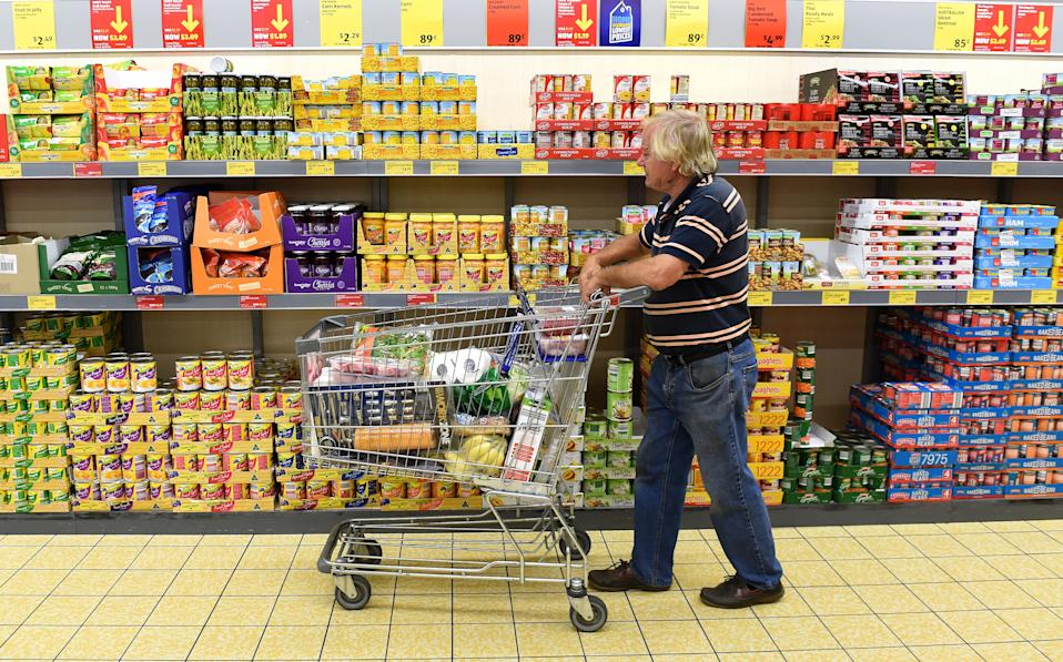 A pensioner shops in an Aldi grocery store on the Gold Coast, Thursday, April 23, 2015.