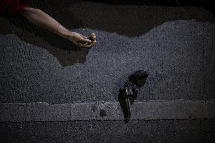 Police have reported killing nearly 4,000 people in their anti-drug crackdown; thousands more have died in unexplained circumstances (AFP Photo/NOEL CELIS)