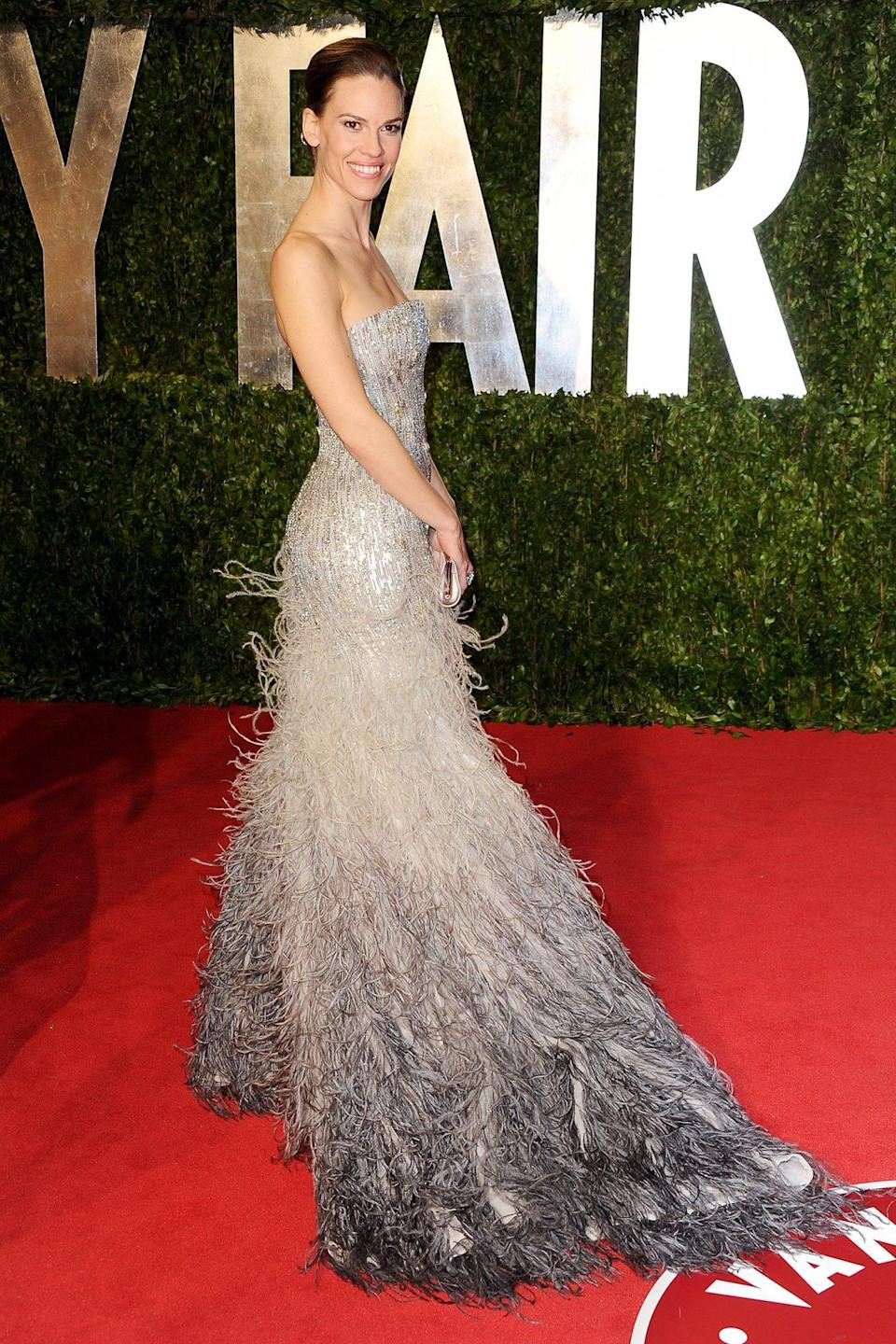 <p>Hilary Swank floated into the Oscars in an ombré feather and sequin Gucci number. </p>
