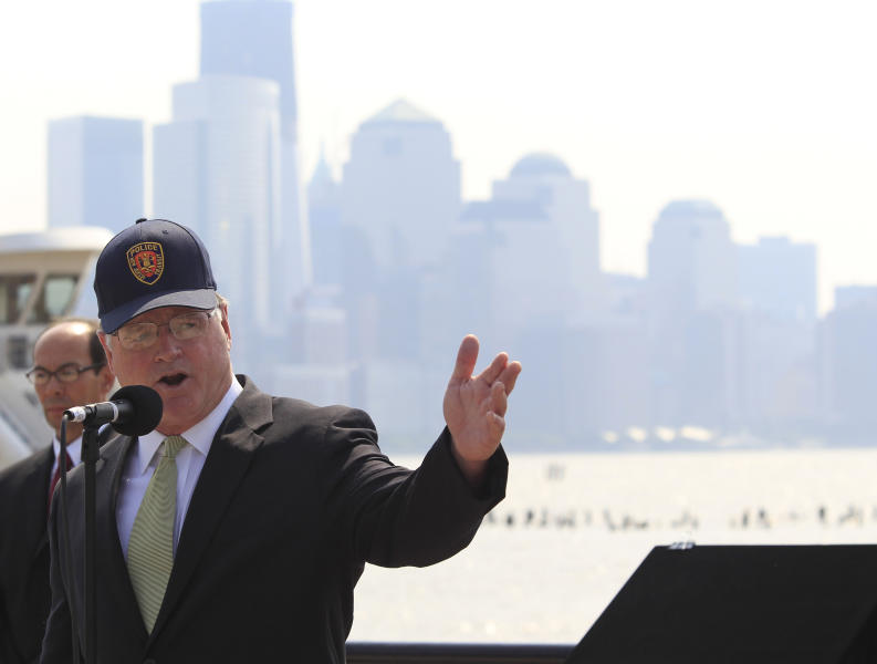 FILE - In this Wednesday, Sept. 14, 2011 file photo, with Lower Manhattan's financial district to his back, Jersey City Mayor Jerramiah Healy addresses the crowd during a ceremony in which a plaque honoring Sept. 11 was unveiled at the Hoboken waterfront at the Hoboken Terminal, in Hoboken, N.J. In Jersey City, the mayor's race is a battle of old versus new. The campaign between 62-year-old Healy and 36-year-old Steven Fulop personifies the gentrification playing out in cities across the country, from California's Bay Area to New York City, as young, mostly white professionals priced out of certain areas build new lives _ and in some places a new political culture _ amid swaths of the old guard. (AP Photo/Julio Cortez, File)