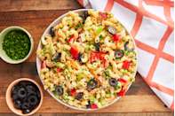 "<p>Whether you grab leftover spaghetti out of your fridge or take the time to make something new before you leave home, <a href=""https://www.delish.com/cooking/g1341/pasta-salad/"" rel=""nofollow noopener"" target=""_blank"" data-ylk=""slk:pasta tastes great cold or warm at the beach"" class=""link rapid-noclick-resp"">pasta tastes great cold or warm at the beach</a>.</p>"