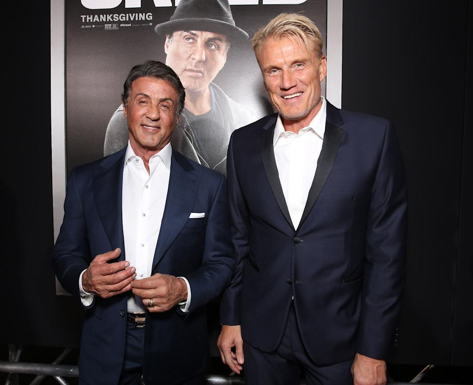 """Stallone and Lundgren attend the premiere of """"Creed"""" in 2015. (Photo: Todd Williamson via Getty Images)"""