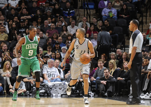 SAN ANTONIO, TX - DECEMBER 15: Tony Parker #9 of the San Antonio Spurs drives against Rajon Rondo #9 of the Boston Celtics during the game between the Boston Celtics and the San Antonio Spurs on December 15, 2012 at the AT&T Center in San Antonio, Texas