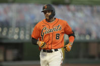 San Francisco Giants' Hunter Pence runs the bases after hitting a three run home run off Oakland Athletics' Jesus Luzardo in the third inning of a baseball game Friday, Aug. 14, 2020, in San Francisco. (AP Photo/Ben Margot)