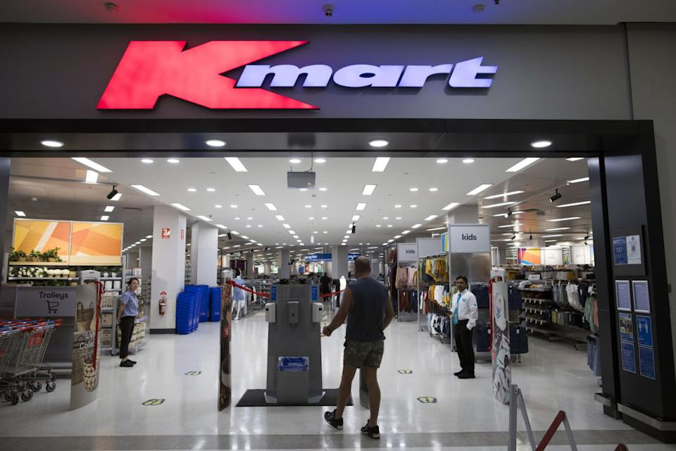 A customer walks toward a hand sanitiser dispenser at a Kmart store in Sydney. Source: Getty