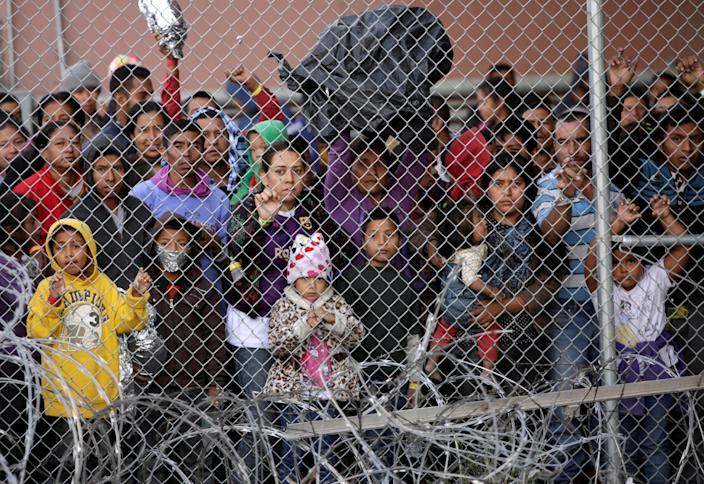 Central American migrants are seen inside an enclosure where they are being held by U.S. Customs and Border Protection (CBP), after crossing the border between Mexico and the United States illegaly and turning themselves in to request asylum, in El Paso, Texas, U.S. March 27, 2019. (Photo: Jose Luis Gonzalez/Reuters)