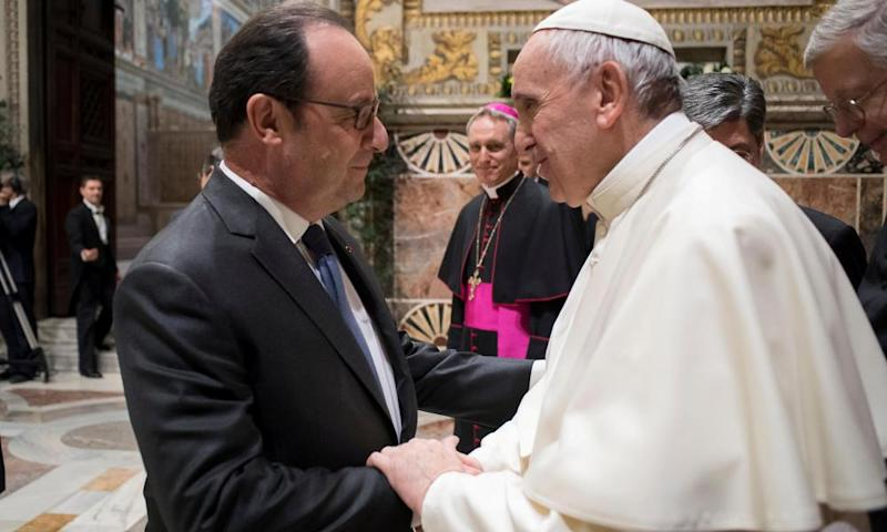 Pope Francis greets French president Francois Hollande during a meeting with EU leaders at the Vatican.