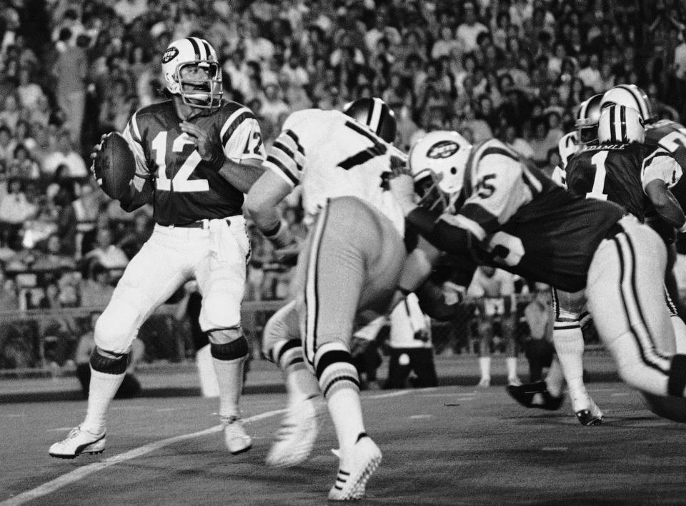 FILE- In this Sept. 2, 1973, file photo, New York Jets' Joe Namath (12) gets set to pass as New Orleans Saints Billy Newsome (78) puts on the pressure and Jets' Winston Hill (75) blocks. Hill was posthumously selected last year for the centennial class of the Pro Football Hall of Fame after a 15-year career. (AP Photo, File)