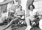 <p><em>Tarzan's </em>Johnny Weissmuller traded sweaters and snow for speedos and sun when he spent the holiday season in Palm Springs, California. The Hollywood star was accompanied by Mexican actress, Lupe Vélez<em>. </em></p>
