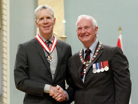 File Photo: Radio broadcaster McLean shakes hands with Governor General Johnston after being awarded the Order of Canada in Ottawa