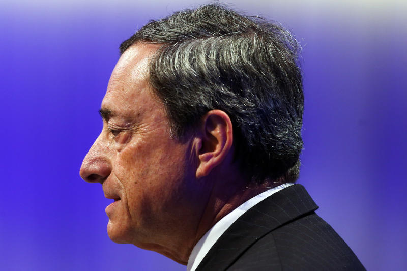 The President of the European Central Bank, ECB, Mario Draghi delivers the opening speech at the annual meeting of the ruling Christian Democratic Union, CDU, party's Economic Council in Berlin, Germany, Tuesday, June 25, 2013. (AP Photo/Markus Schreiber)