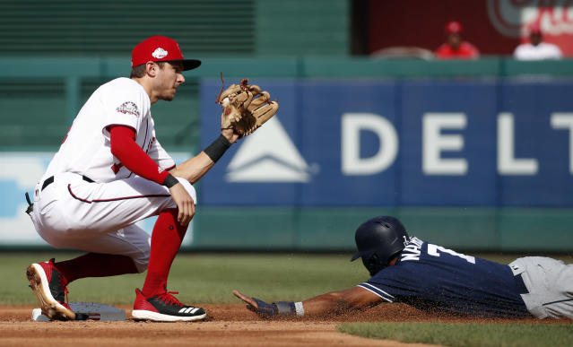 Washington Nationals shortstop Trea Turner catches the throw, but can't make the tag in time as San Diego Padres' Manuel Margot safely steals second base during the third inning of a baseball game at Nationals Park, Wednesday, May 23, 2018, in Washington. (AP Photo/Alex Brandon)